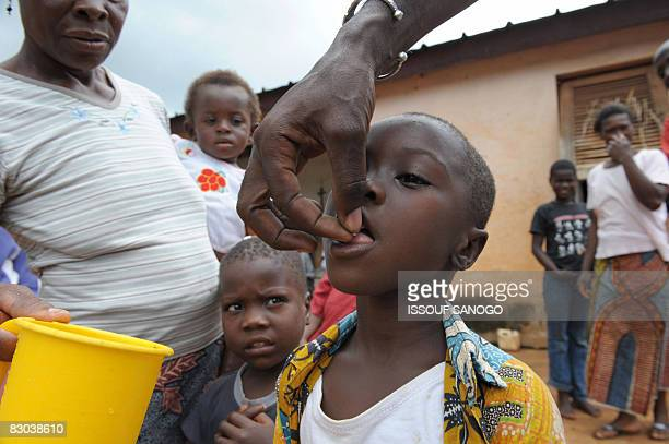 Christophe KOFFI A nurse Mamadou Kone gives medecine ivermectin against onchocerciasis or river blindness caused by a parasitic worm and spread by...