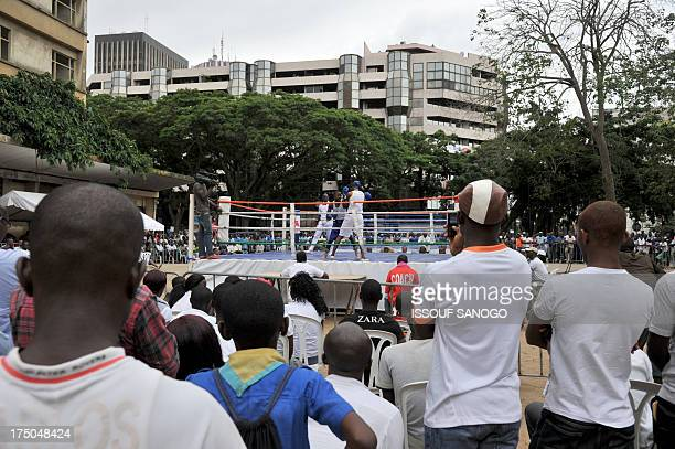 Christophe KOFFI The crowd watches boys fighting in a amature boxing match held on an openair ring on the former site Sorbonne in the business...