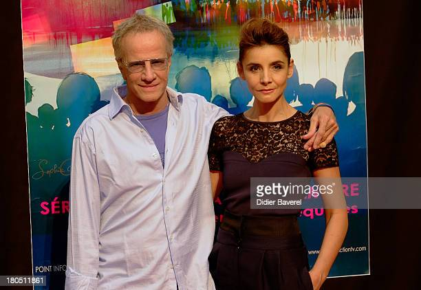 Christophe Lambert and Clotilde Coureau pose during the photocall of 'La Source' at 15th Festival of TV Fiction on September 13, 2013 in La Rochelle,...