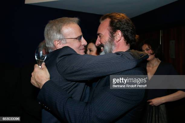 Christophe Lambert and Jean Dujardin attend the 'Chacun sa vie' Paris Premiere at Cinema UGC Normandie on March 13 2017 in Paris France