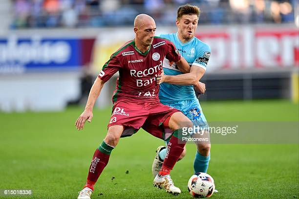 Christophe Lepoint midfielder of SV Zulte Waregem is fighting for the ball with Thomas Foket midfielder of KAA Gent during the Jupiler Pro League...