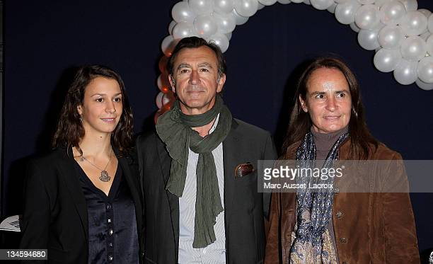 Christophe Malavoy his wife Isabelle and his daughter Camille poses for the premiere of 'Mamma Mia' Paris Premiere at Theatre Mogador on October 28...
