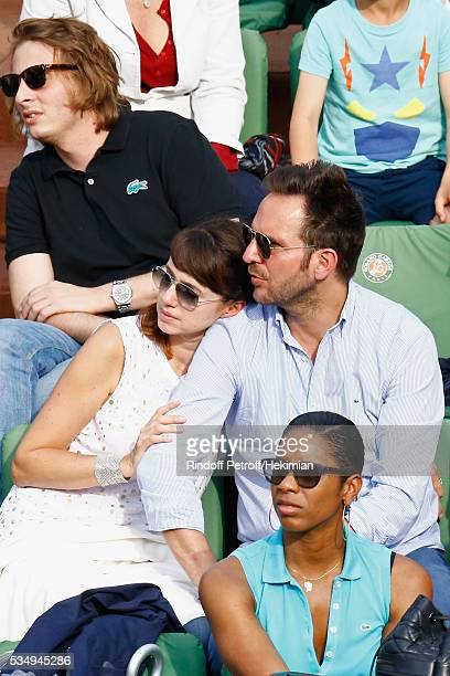 Christophe Michalak and Delphine McCarty attend the Jo Wilfied Tsonga match during the French Tennis Open at Roland Garros on May 28 2016 in Paris...