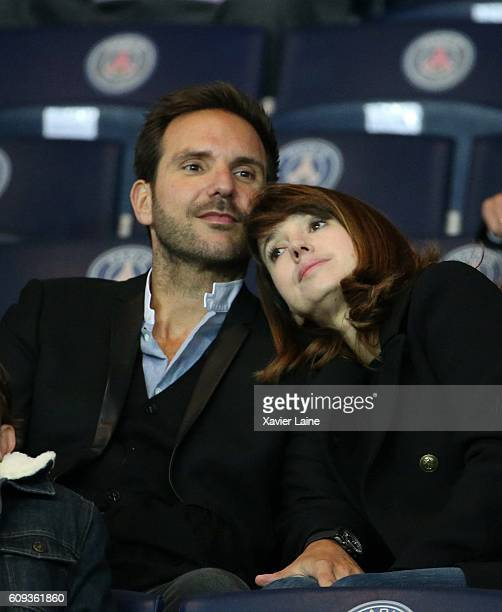 Christophe Michalak and his wife Delphine McCarty attends the French Ligue 1 match between Paris SaintGermain and Dijon FCO at Parc des Princes on...