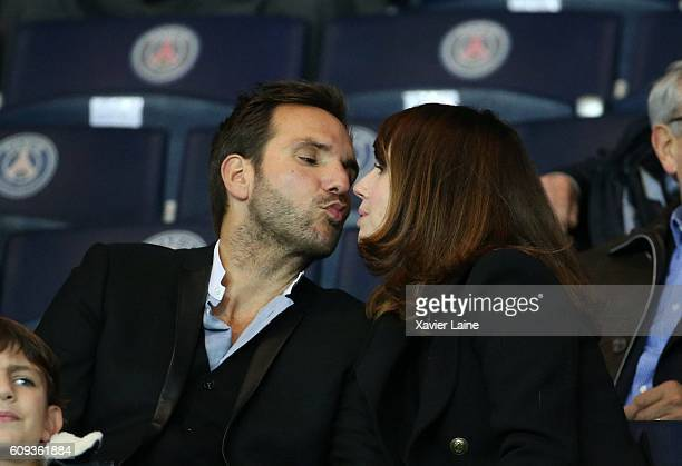 Christophe Michalak kiss his wife Delphine McCarty during the French Ligue 1 match between Paris SaintGermain and Dijon FCO at Parc des Princes on...
