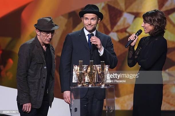 Christophe Miossec and David Ford receive the 'Chanson Originale' award during the 'Les Victoires de la musique 2014' ceremony at Le Zenith on...