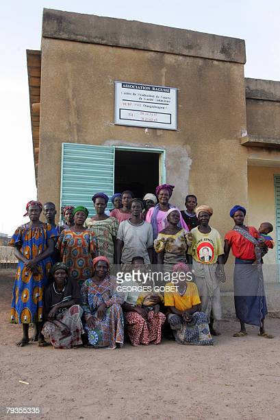 Christophe PARAYRE Burkinabe women of the Ragussi association pose 14 January 2008 outside the organic shea butter production workshop in the village...