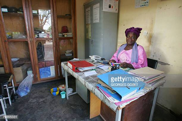 Christophe PARAYRE Henriette Ouedraogo the president of the Ragussi association poses 14 January 2008 in her office at the organic shea butter...