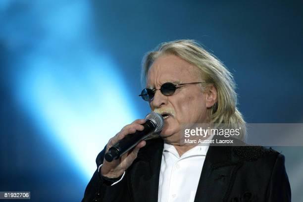 Christophe performs live during Le Concert de La Fraternite Champ Libre at Champs de Mars on July 14 2008 in Paris France