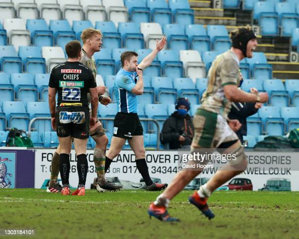 Christophe Ridley, the referee signals the end of the match after Ollie Sleightholme of Northampton Saints had charged down a conversion kick by Joe...
