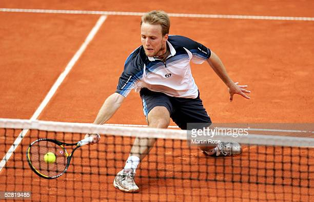Christophe Rochus of Belgium in action against Juan Ignacio Chela of Argentina during the Masters Series Hamburg at Rothenbaum on May 13 2005 in...