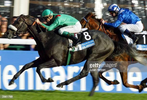 Christophe Soumillon and Dalakhani get the better of the Richard Hills ridden Mubtaker to land The Prix De L'Arc De Triomphe race run at Longchamp...