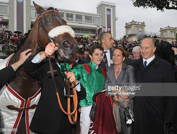 Christophe Soumillon poses with Aga Khan and Zarkava after winning the Qatar Prix de l'Arc de Triomphe on 0ctober 05 2008 in Longchamp France