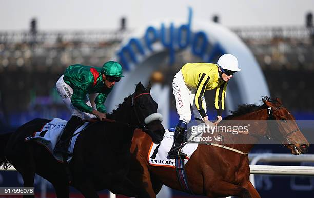 Christophe Soumillon riding Vazirabad on the way to victory against Jamie Spencer on Big Orange in the Dubai Gold Cup Sponsored By Al Tayer Motors as...