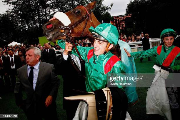 Christophe Soumillon winner of Le Prix de Diane race poses with his horse on June 08 2008 in Chantilly France