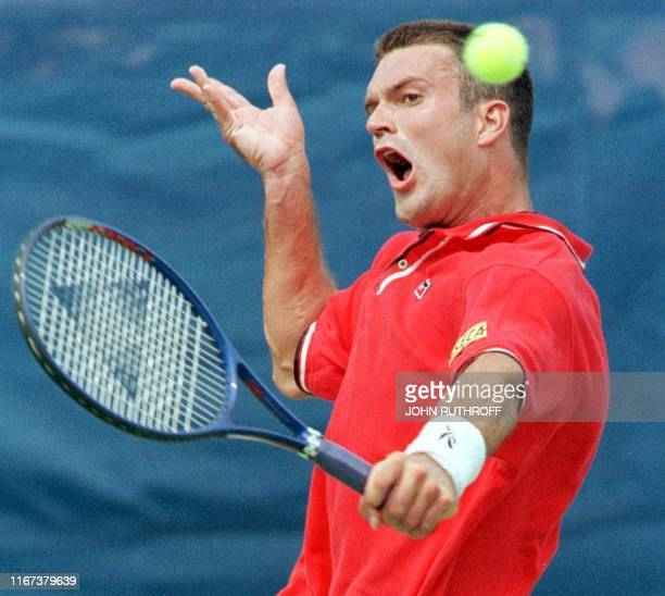 Christophe Van Garsse of Belgium fires a backhand shot during the quarter-final round of the Davis Cup Tennis Championship at the Indianapolis Tennis...