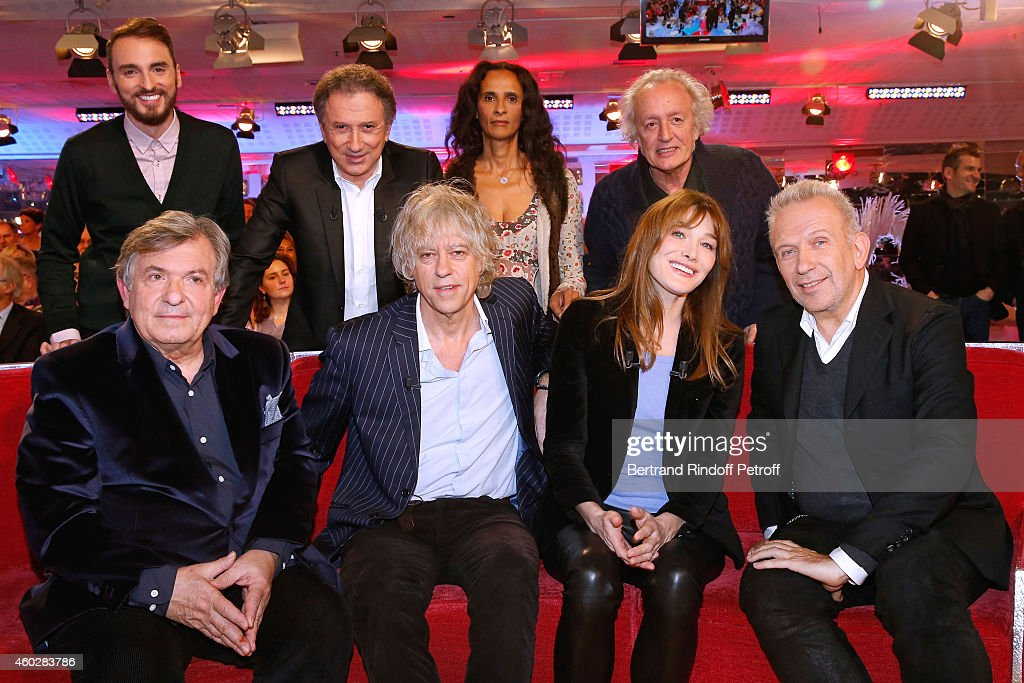 Christophe Willem, Michel Drucker, Karine Silla, Didier Barbelivien, (Front L-R) Jacques Leibowitch, Bob Geldof, Carla Bruni and Jean-Paul Gaultier attend the 'Vivement Dimanche' French TV at Pavillon Gabriel on December 10, 2014 in Paris, France.