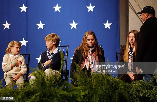 Christopher 6, Patrick 10, Christina,12 and Katherine the children of Governor-Elect Arnold Schwarzenegger sit and wait on the stage as their mother...