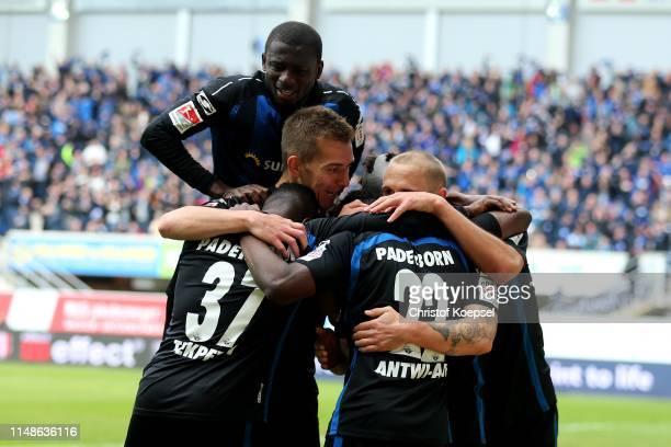 Christopher AbntwiAdjei of Paderborn celebrates the third goal with his team mates during the Second Bundesliga match between SC Paderborn 07 and...