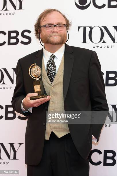 """Christopher Akerlind, winner of the award for Best Lighting Design of a Play for """"Indecent,"""" poses in the press room during the 2017 Tony Awards at..."""