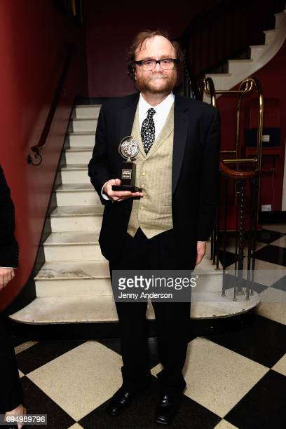 """Christopher Akerlind, winner of the award for Best Lighting Design of a Play """"?Indecent"""" poses in the press room during the 2017 Tony Awards at 3..."""