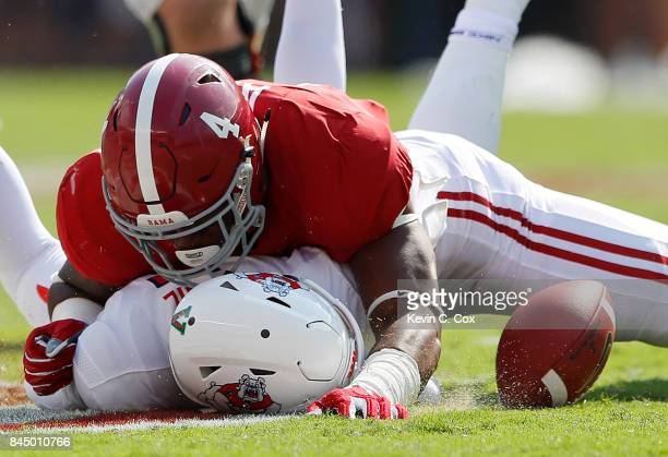 Christopher Allen of the Alabama Crimson Tide dives on Chason Virgil of the Fresno State Bulldogs as he fumbles a recovery at BryantDenny Stadium on...