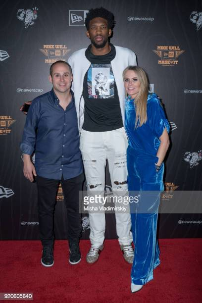 Christopher and Lindsey Koch Ceo and CoOwner of New Era Cap pose with Joel  Embiid on beb4de1c00b