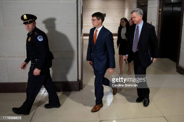 Christopher Anderson center former aide to former US special representative for Ukraine negotiations Kurt Volker arrives for a closed door meeting to...
