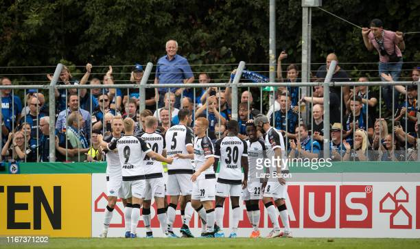 Christopher Antwi Adjei of Paderborn celebrates with team mates after scoring his teams second goal during the DFB Cup first round match between SV...