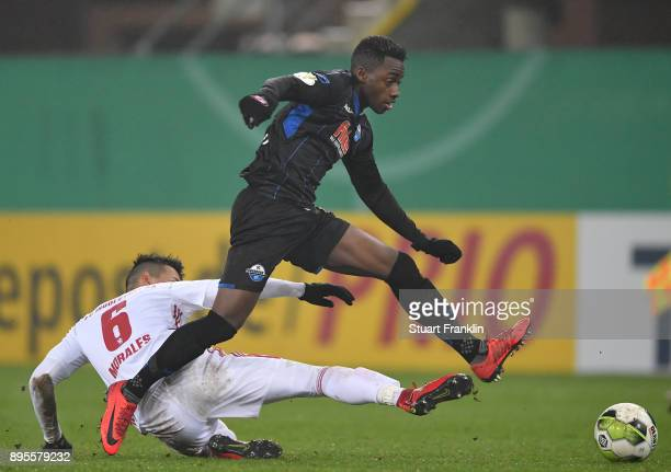 Christopher AntwiAdjej of Paderborn is challenged by Alfredo Morales of Ingolstadt during the DFB Cup match between SC Paderborn and FC Ingolstadt at...