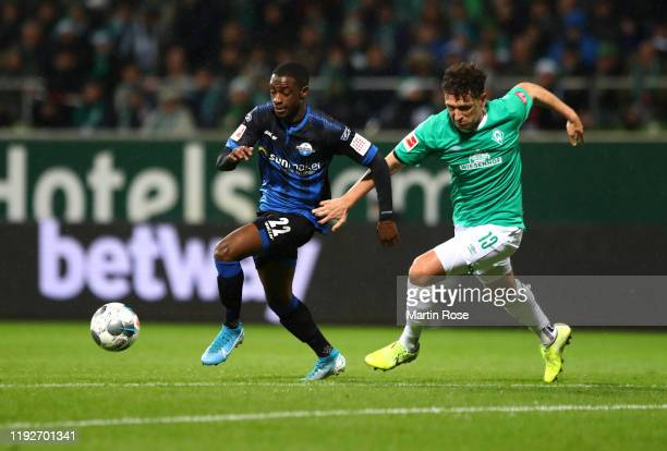Christopher Antwi-Adjej of SC Paderborn 07 battles for possession with Milos Veljkovic of SV Werder Bremen during the Bundesliga match between SV...