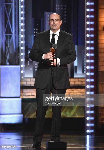"""Christopher Ashley accepts the award for Best Direction of a Musical for """"Come From Away"""" onstage during the 2017 Tony Awards at Radio City Music..."""