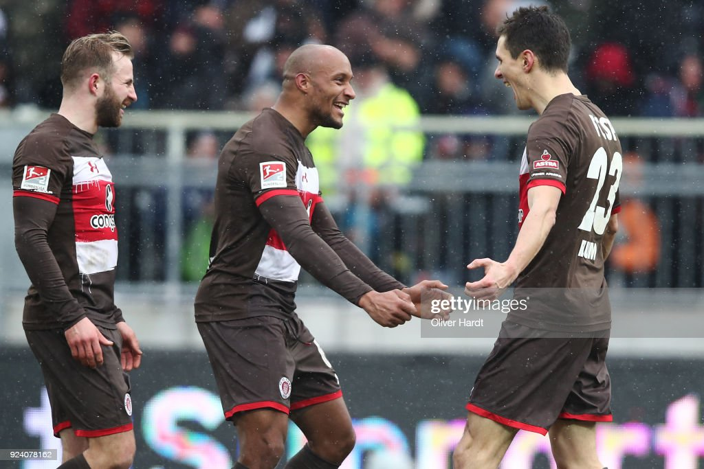Christopher Avevor and Joahannes Flum of Hamburg celebrate after the Second Bundesliga match between FC St. Pauli and Holstein Kiel at Millerntor Stadium on February 25, 2018 in Hamburg, Germany.