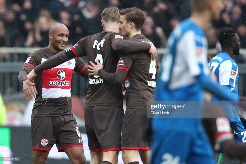 (L-R Christopher Avevor, Lasse Sobiech and Philipp Ziereis of Hamburg celebrate after the Second Bundesliga match between FC St. Pauli and Holstein Kiel at Millerntor Stadium on February 25, 2018 in Hamburg, Germany.