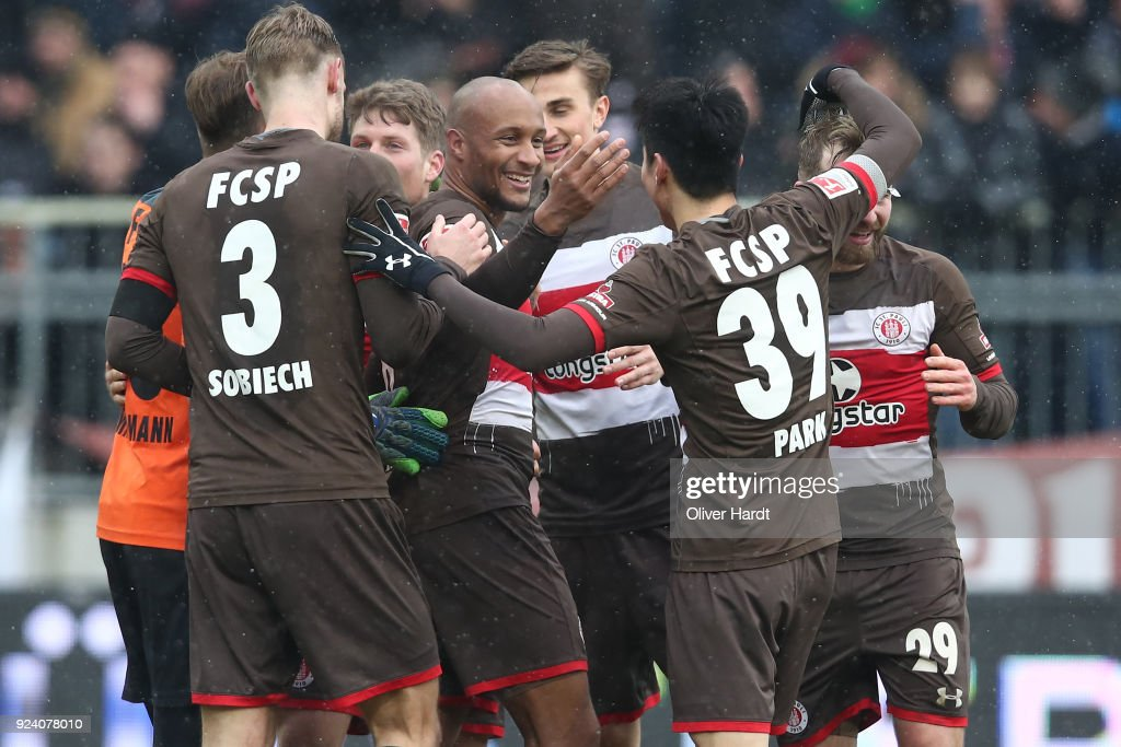 Christopher Avevor (C) of Hamburg celebrate after the Second Bundesliga match between FC St. Pauli and Holstein Kiel at Millerntor Stadium on February 25, 2018 in Hamburg, Germany.