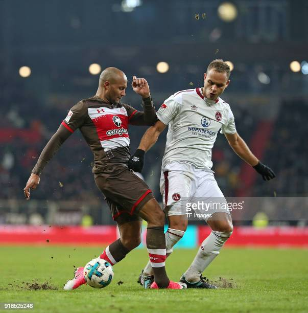 Christopher Avevor of St Pauli and Ewerton of Nuernberg battle for the ball during the Second Bundesliga match between FC St Pauli and 1 FC Nuernberg...