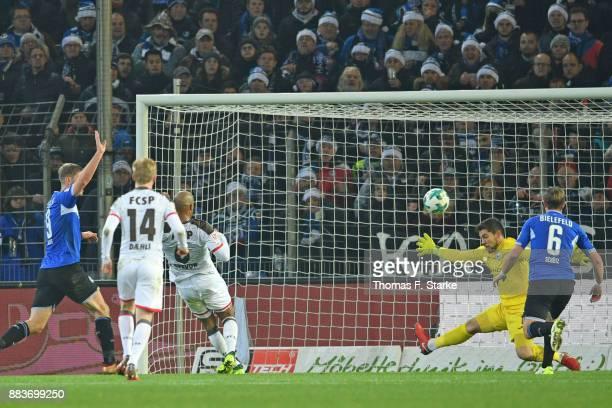 Christopher Avevor of St Pauli scores an irregular goal againt Stefan Ortega Moreno of Bielefeld during the Second Bundesliga match between DSC...