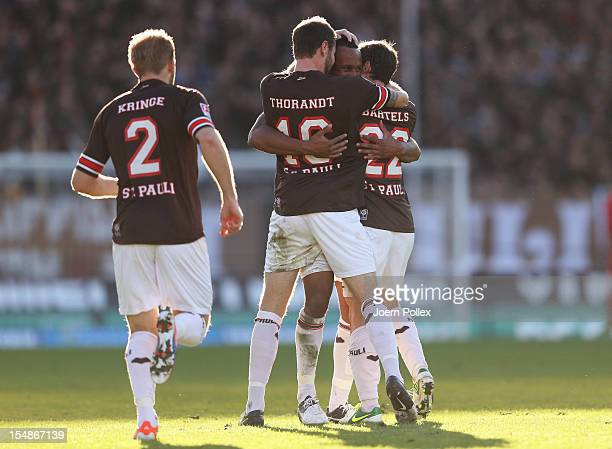 Christopher Avevor of St. Paulicelebrates with his team mates after scoring his team's second goal during the Second Bundesliga match between FC St....