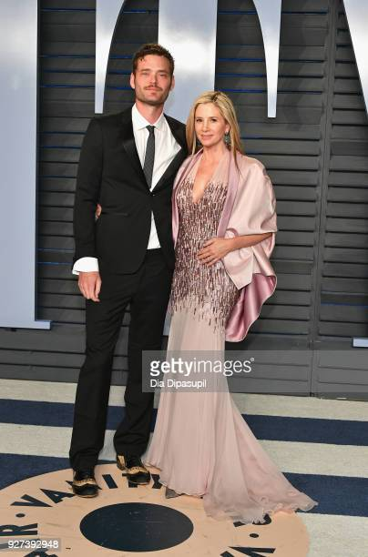 Christopher Backus and Mira Sorvino attend the 2018 Vanity Fair Oscar Party hosted by Radhika Jones at Wallis Annenberg Center for the Performing...