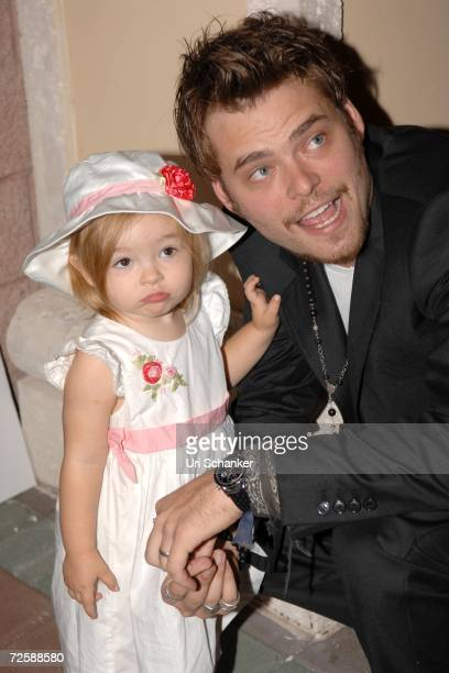 Christopher Backus poses with his daughter Mattea Angel pose at the unveiling of Paul Sorvino's sculpture at the Boca Raton Museum of Art on November...