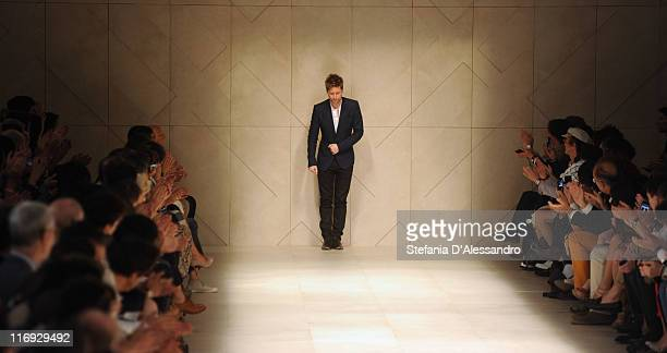 Christopher Bailey acknowledges the audience after the Burberry Prorsum fashion show as part of Milan Fashion Week Menswear Spring/Summer 2012 on...