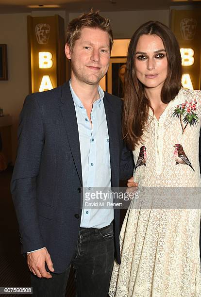 Christopher Bailey and Keira Knightley attend the Green Carpet Challenge 2016 BAFTA Night to Remember on September 18 2016 in London England