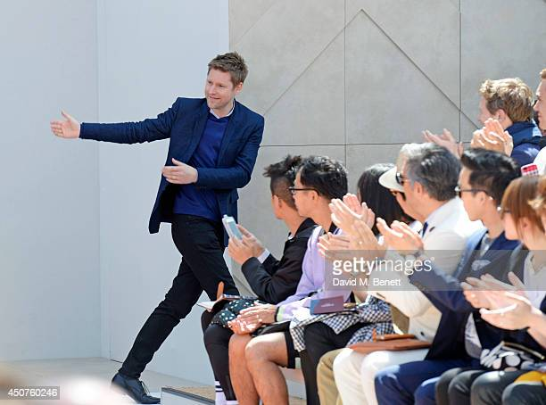 Christopher Bailey bows on the runway at Burberry Prorsum SS15 during London Collections Men at Kensington Gardens on June 17 2014 in London England