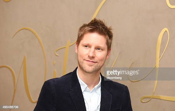 Christopher Bailey, chief executive officer of Burberry Group Plc, stands for a photograph as he arrives at an event to launch the Burberry festive...