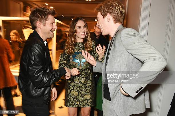 Christopher Bailey Lily James and Domhnall Gleeson wearing Burberry attend an event to celebrate 'The Tale of Thomas Burberry' at Burberry's all day...