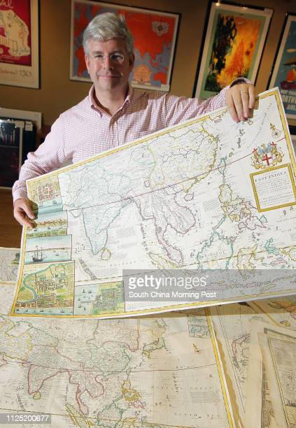 Christopher Bailey of Picture This poses to photorapher with his old Hong Kong maps collections Tuesday June 21st at the Picture This Gallery located...