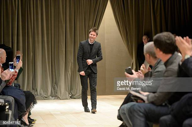 Christopher Bailey poses on the runway at the Burberry Menswear January 2016 Show on January 11, 2016 in London, United Kingdom.