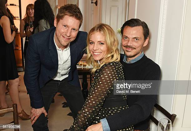 Christopher Bailey Sienna Miller and Matthew Williamson attend the launch of Wendy Rowe's new book 'Eat Beautiful' hosted by Sienna Miller at...