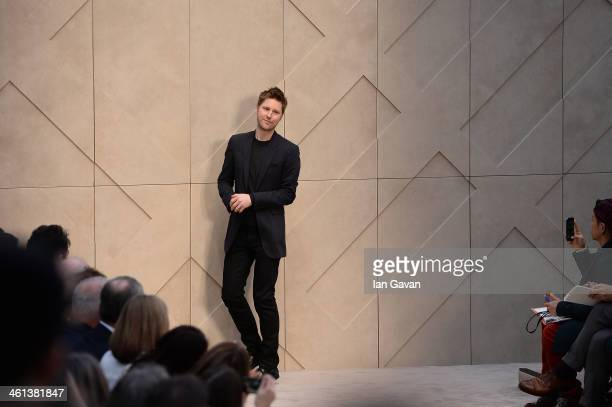 Christopher Bailey sits in the front row during Burberry AW14 Menswear Show at Kensington Gardens on January 8, 2014 in London, England.