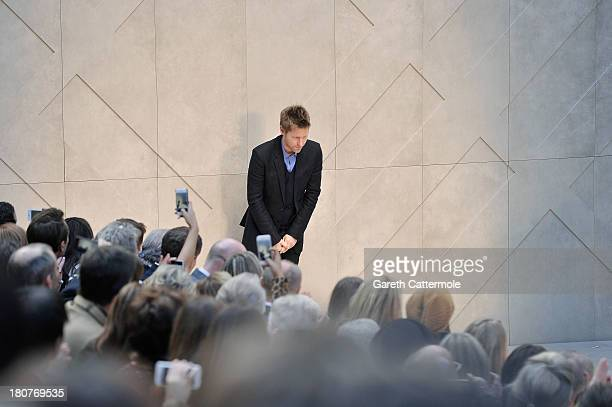 Christopher Bailey takes a bow after the Burberry Prorsum Womenswear Spring/Summer 2014 show during London Fashion Week at Kensington Gardens on...
